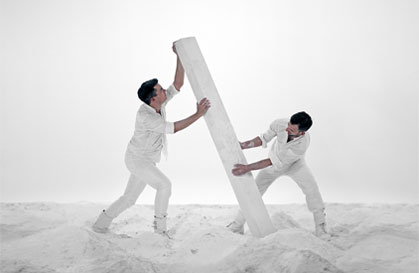 Men in white lifting white sculpture image